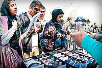 Iranians shopping before Noruz, the persian new year on the first day of spring. Informal economy represents more than a quarter of Iran's economu.