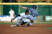 Bradenton Marauders shortstop Alfredo Reyes (13) puts the tag on Tampa Yankees center fielder Jeff Hendrix (31) during a stolen base attempt during the second game of a doubleheader against the Tampa Yankees on June 14, 2017 at LECOM Park in Bradenton, Florida.  Tampa defeated Bradenton 5-1.  (Mike Janes/Four Seam Images)