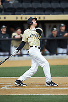 D.J. Poteet (4) of the Wake Forest Demon Deacons follows through on his swing against the Louisville Cardinals at David F. Couch Ballpark on March 18, 2018 in  Winston-Salem, North Carolina.  The Demon Deacons defeated the Cardinals 6-3.  (Brian Westerholt/Four Seam Images)