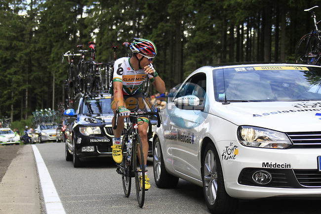 Robert Hunter (RSA) Garmin-Sharp with the medical car at the tail end of the peloton as they climb the Cote de Francorchamps during Stage 1 of the 99th edition of the Tour de France, running 198km from Liege to Seraing, Belgium. 1st July 2012.<br /> (Photo by Eoin Clarke/NEWSFILE)