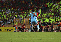 Costa Rica's goalie,  Esteban Alvarado (1), and Cristian Gamboa (12) share a mid-air hug in celebration of their first goal against Egypt during the FIFA Under 20 World Cup Round of 16 match at the Cairo International Stadium on October 06, 2009 in Cairo, Egypt.