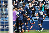 KANSAS CITY, KS - MAY 16: Sporting KC players celebrate their third goal during a game between Vancouver Whitecaps and Sporting Kansas City at Children's Mercy Park on May 16, 2021 in Kansas City, Kansas.