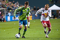 Brad Evans (l) moves the ball against Joel Lindpere (r) as the Seattle Sounders lost to the New York Red Bulls, 1-0, in an MLS match on Saturday, April 3, 2010 at Qwest Field in Seattle, WA.