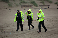 Pictured: Police attending at Cefn Sidan beach, near Pembrey west Wales, UK. Saturday 21 May 2016<br />