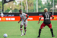 LAKE BUENA VISTA, FL - JULY 13: Richie Laryea #22 of Toronto FC passes the ball during a game between D.C. United and Toronto FC at Wide World of Sports on July 13, 2020 in Lake Buena Vista, Florida.