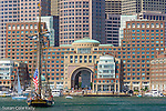 The Pride of Baltimore II sails under the Boston financial district on Boston Harbor, Boston, Massachusetts, USA