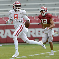 Arkansas receiver Mike Woods (8) makes a catch Saturday, April 3, 2021, ahead of defensive back Khari Johnson during a scrimmage at Razorback Stadium in Fayetteville. Visit nwaonline.com/210404Daily/ for today's photo gallery. <br /> (NWA Democrat-Gazette/Andy Shupe)
