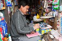 Kathmandu, Nepal.  Shopkeeper Doing his Accounts.