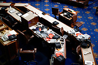 Papers and other equipment after the House floor was evacuate as protesters tried to break into the House Chamber at the U.S. Capitol on Wednesday, Jan. 6, 2021, in Washington. (AP Photo/J. Scott Applewhite)