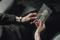 Elderly hands, holding a family photo, New Jersey