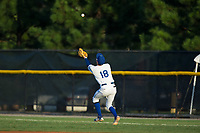 Burlington Royals first baseman chases down a fly ball in shallow right field during the game against the Danville Braves at Burlington Athletic Stadium on August 12, 2017 in Burlington, North Carolina.  The Braves defeated the Royals 5-3.  (Brian Westerholt/Four Seam Images)