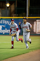 AZL Reds right fielder Reniel Ozuna (29) jogs off the field with second baseman Cash Case (4) between innings of the game against the AZL Giants on August 12, 2017 at Scottsdale Stadium in Scottsdale, Arizona. AZL Giants defeated the AZL Reds 1-0. (Zachary Lucy/Four Seam Images)