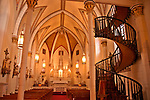 Loretto Chapel with the mysterious spiral staircase because no one knows who built it or how it was constructed as there is no visible means of support; Santa Fe, New Mexico