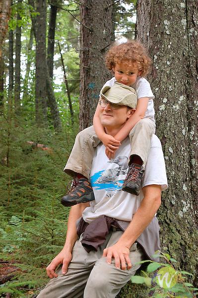 Uncle Tolston and Ellie hiking Burnt Jacket trail.