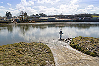 Pictured: A young boy stands on the edge of the slipway where the Mini car with Kiara Moore entered river Teifi from in Cardigan, west Wales, UK. Tuesday 20 March 2018<br /> Re: The funeral of two year old Kiara Moore, who died after being recovered from a silver Mini car found in river Teifi in Cardigan will be held today (Tue 27 Mar 2018) at Parc Gwyn Crematorium, Narberth, west Wales.<br /> Kiara was taken at the University Hospital of Wales in Cardiff after being rescued but was pronounced dead.<br /> It is believed the car she was in, rolled down a slipway while her mother got out momentarily to get cash out of the family business premises.<br /> Her parents Jet Moore and Kim Rowlands have expressed their grief on social media.
