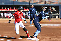GREENSBORO, NC - FEBRUARY 22: Amanda Ulzheimer #7 of Fairfield University beats the throw to Lexi Godwin #6 of the University of North Carolina at first base during a game between Fairfield and North Carolina at UNCG Softball Stadium on February 22, 2020 in Greensboro, North Carolina.
