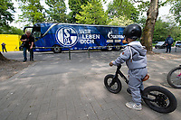 16th May 2020, Signal Iduna Park, Dortmund, Germany; Bundesliga football, Borussia Dortmund versus FC Schalke;  Outdoor shot before the first matchday of the Ghost Games because of the coronavirus In the picture Bus arrival FC Schalke 04 watched by a child on a bicycle