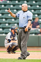Home plate umpire Aaron Larsen between innings of the Carolina League game between the Wilmington Blue Rocks and the Winston-Salem Dash at BB&T Ballpark on June 10, 2012 in Winston-Salem, North Carolina.  The Dash defeated the Blue Rocks 2-0.  (Brian Westerholt/Four Seam Images)