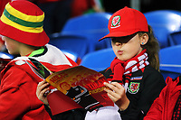 A young Wales fan reads the programme during the FIFA World Cup Qualifier Group D match between Wales and Republic of Ireland at The Cardiff City Stadium, Wales, UK. Monday 09 October 2017