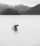 Lone fisherman on Lake Kawaguchiko, Mt Fuji, Japan