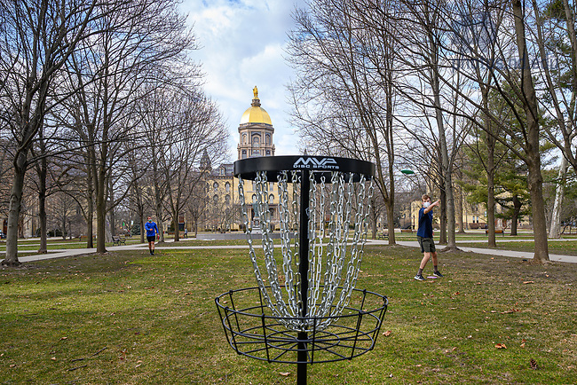 March 8, 2021; Sorin Hall residents play disc golf on Main Quad with a portable disc golf target. (Photo by Matt Cashore/University of Notre Dame)