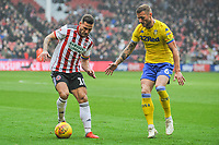 Sheffield United's forward Billy Sharp (10) held up by Leeds United's defender Liam Cooper (6) during the Sky Bet Championship match between Sheff United and Leeds United at Bramall Lane, Sheffield, England on 1 December 2018. Photo by Stephen Buckley / PRiME Media Images.