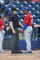 Buffalo Bison manager Bob Meacham (right) discusses a call with home plate umpire Richard Riley during the game against the Durham Bulls at Durham Bulls Athletic Park on April 25, 2018 in Allentown, Pennsylvania.  The Bison defeated the Bulls 5-2.  (Brian Westerholt/Four Seam Images)