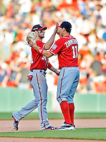 9 June 2012: Washington Nationals outfielder Bryce Harper (34) gets high fives from teammates after the game against the Boston Red Sox at Fenway Park in Boston, MA. The Nationals defeated the Red Sox 4-2 in the second game of their 3-game series. Mandatory Credit: Ed Wolfstein Photo