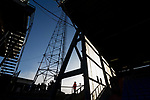 A steward watches Portsmouth fans queuing for drinks under a floodlight pylon at half time. Oldham v Portsmouth League 1