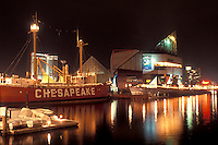 "Inner Harbor, Baltimore, MD, Maryland, Lightship """"Chesapeake"""" and the National Aquarium at the Inner Harbor in downtown Baltimore in the evening."