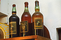 Old bottles of Banyuls 1944, 1934, 1953 in the shop at Cellier des Dominicains in Collioure, Languedoc-Roussillon, France
