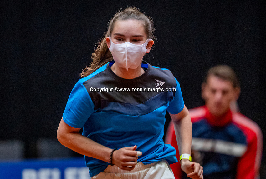 Den Bosch, The Netherlands, April 16, 2021,    Maaspoort, Billy Jean King Cup  Netherlands -  China , First Match: Ballgirl with facemask<br /> Photo: Tennisimages/Henk Koster