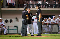Great Falls Voyagers manager Tim Esmay (10) argues with umpires Shin Koishizawa and Casey James during a Pioneer League game against the Missoula Osprey at Centene Stadium at Legion Park on August 19, 2019 in Great Falls, Montana. Missoula defeated Great Falls 1-0 in the second game of a doubleheader. (Zachary Lucy/Four Seam Images)