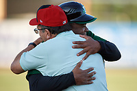 Hall of Fame Catcher Johnny Bench hugs coach Lenny Harris before a Florida State League game between the Daytona Tortugas and Palm Beach Cardinals on April 11, 2019 at Roger Dean Stadium in Jupiter, Florida.  Palm Beach defeated Daytona 6-0.  (Mike Janes/Four Seam Images)