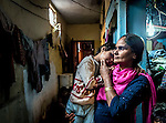 ***SEXUAL ASSAULT VICTIM - COURT PROCEEDINGS IN INDIA HAVE BANNED IDENTIFYING THE VICTIM***<br /> 8 November 2013, Govindpuri, Delhi , INDIA: Six year old Daisy with her mother Chand Bibi outside of the tiny one bedroom home she shares with her two siblings and parents in Govindpuri, Delhi. Daisy has been the victim of a sexual assault and it has been devastating for her and her family. Many girls face a variety of hurdles to receiving an education in India that range from ease of access to schools, traditional beliefs in the community, sexual abuse and poverty. Picture by Graham Crouch/ Good Weekend