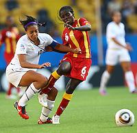 USA's Sydney Leroux (L) and Elizabeth Cudjoe of Ghana during the FIFA U20 Women's World Cup at the Rudolf Harbig Stadium in Dresden, Germany on July 14th, 2010.