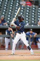 Right fielder Gerson Molina (12) of the Columbia Fireflies bats in a game against the Rome Braves on Tuesday, June 4, 2019, at Segra Park in Columbia, South Carolina. Columbia won, 3-2. (Tom Priddy/Four Seam Images)
