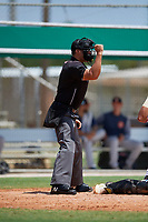 Umpire Ryne Sigmon calls a strike during a Gulf Coast League game between the GCL Astros and GCL Marlins on August 8, 2019 at the Roger Dean Chevrolet Stadium Complex in Jupiter, Florida.  GCL Astros defeated GCL Marlins 4-2.  (Mike Janes/Four Seam Images)