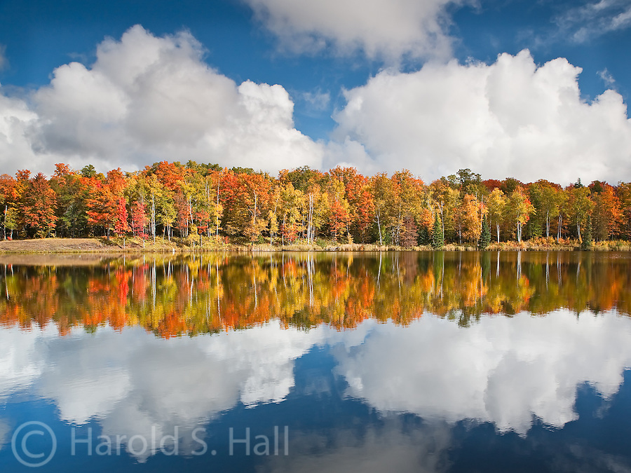 The fall colors in northern Michigan reflect in Alberta Pond.