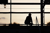 A fan sits at the top of the stands at Burlington Athletic Park  during the Appalachian League game between the Bluefield Ridge Runners and the Burlington Sock Puppets on June 8, 2021 in Burlington, North Carolina. (Brian Westerholt/Four Seam Images)