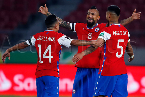 13th November 2020; National Stadium of Santiago, Santiago, Chile; World Cup 2020 Football qualification, Chile versus Peru;  Arturo Vidal of Chile celebrates his goal with Fabián Orellana and Paulo Díaz in the 20th minute 1-0