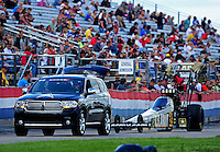 Sept 9, 2012; Clermont, IN, USA: The car of NHRA top fuel dragster driver Tony Schumacher is towed back to the pits  during the US Nationals at Lucas Oil Raceway. Mandatory Credit: Mark J. Rebilas-