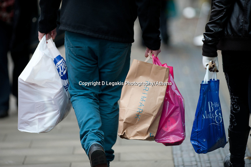 Saturday 14 December 2013<br /> Pictured: Shoppers Carry bags through Swansea's Oxford street<br /> Re: Towns and City's are busy with shoppers  across the UK as Christmas  is only 10 days away.