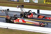 Mar 16, 2014; Gainesville, FL, USA; NHRA top fuel driver Doug Kalitta (near) defeats teammate David Grubnic during the Gatornationals at Gainesville Raceway Mandatory Credit: Mark J. Rebilas-USA TODAY Sports