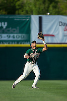 Greensboro Grasshoppers left fielder John Norwood (31) settles under a fly ball during the game against the Hickory Crawdads at L.P. Frans Stadium on May 6, 2015 in Hickory, North Carolina.  The Crawdads defeated the Grasshoppers 1-0.  (Brian Westerholt/Four Seam Images)