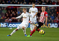 Pictured L-R: Jay Fulton of Swansea against James Ward-Prowse of Southampton Sunday 01 February 2015<br />