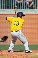 Christ Conley (13) of the Canisius Golden Griffins at bat against the Charlotte 49ers at Hayes Stadium on February 23, 2014 in Charlotte, North Carolina.  The Golden Griffins defeated the 49ers 10-1.  (Brian Westerholt/Four Seam Images)