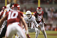 Texas quarterback Casey Thompson (11) carries the ball, Saturday, September 11, 2021 during the fourth quarter of a football game at Reynolds Razorback Stadium in Fayetteville. Check out nwaonline.com/210912Daily/ for today's photo gallery. <br /> (NWA Democrat-Gazette/Charlie Kaijo)