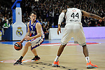 Real Madrid´s Marcus Slaughter and Anadolu Efes´s Thomas Heurtel during 2014-15 Euroleague Basketball Playoffs match between Real Madrid and Anadolu Efes at Palacio de los Deportes stadium in Madrid, Spain. April 15, 2015. (ALTERPHOTOS/Luis Fernandez)
