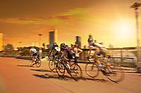 Group of bike cyclists train for a race on the Lamar Street Pedestrian Bridge, The Lady Bird Lake Hike and Bike Trail